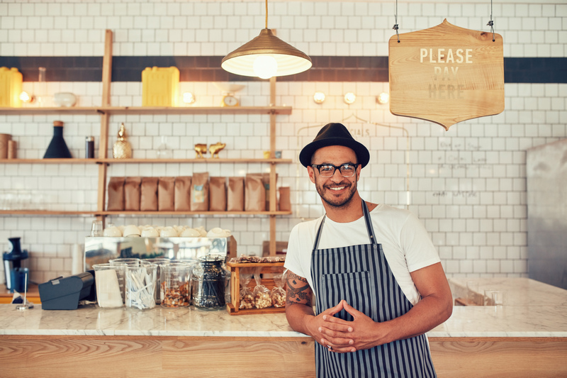 Coffee shop counter with smiling merchant - Small